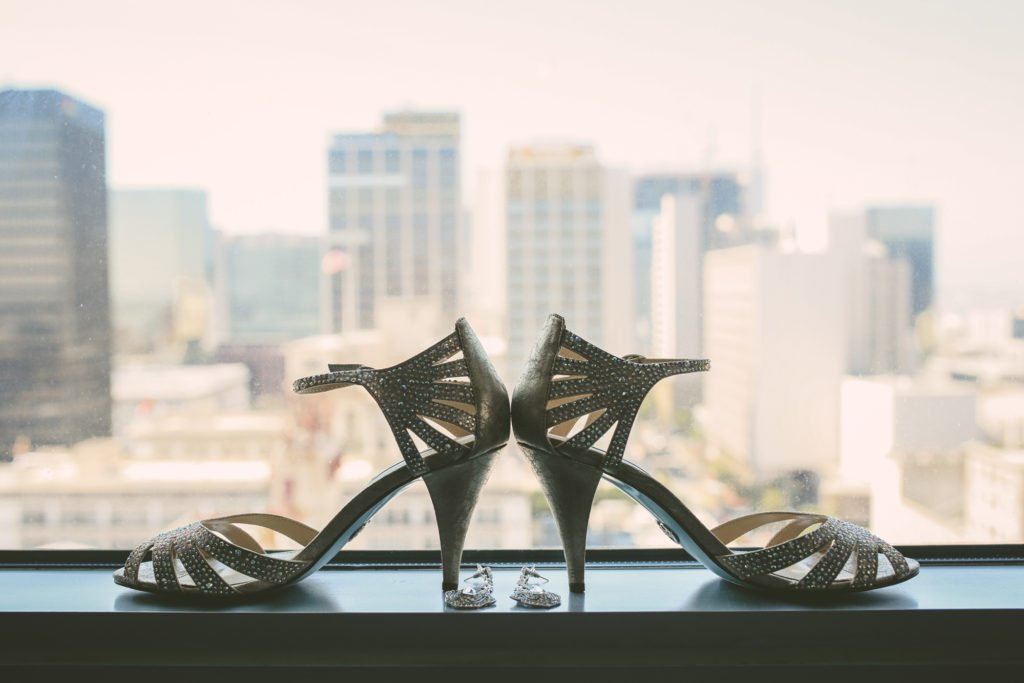 wedding shoes on windowsill overlooking the city