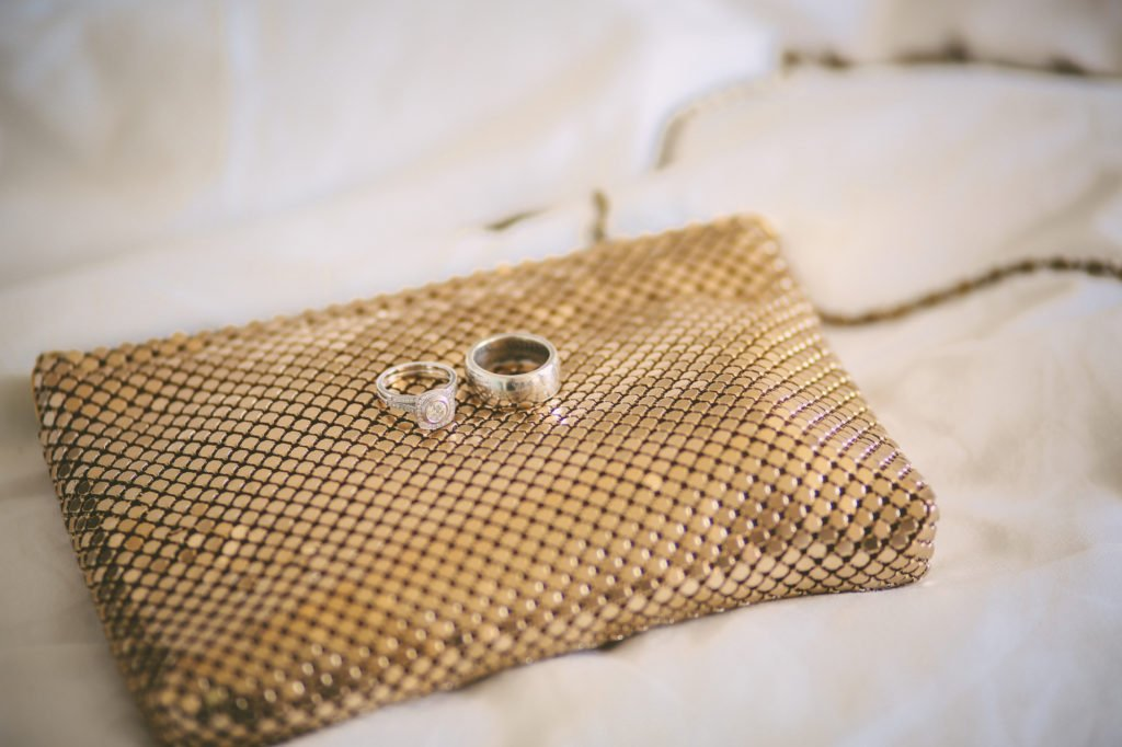 wedding rings on a handbag