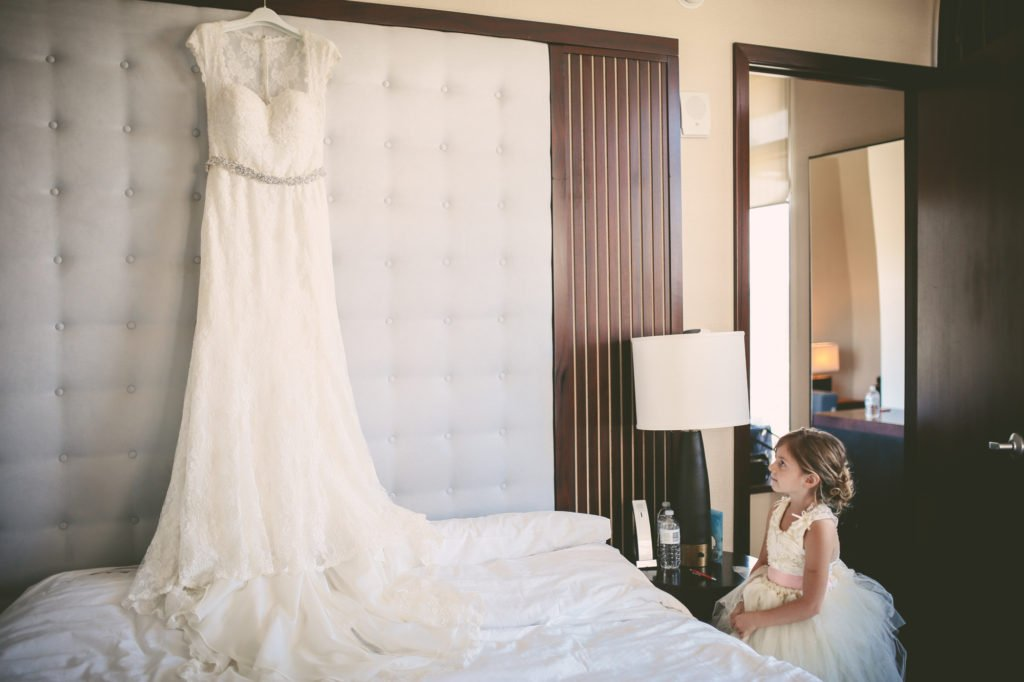 flower girl looking at wedding dress