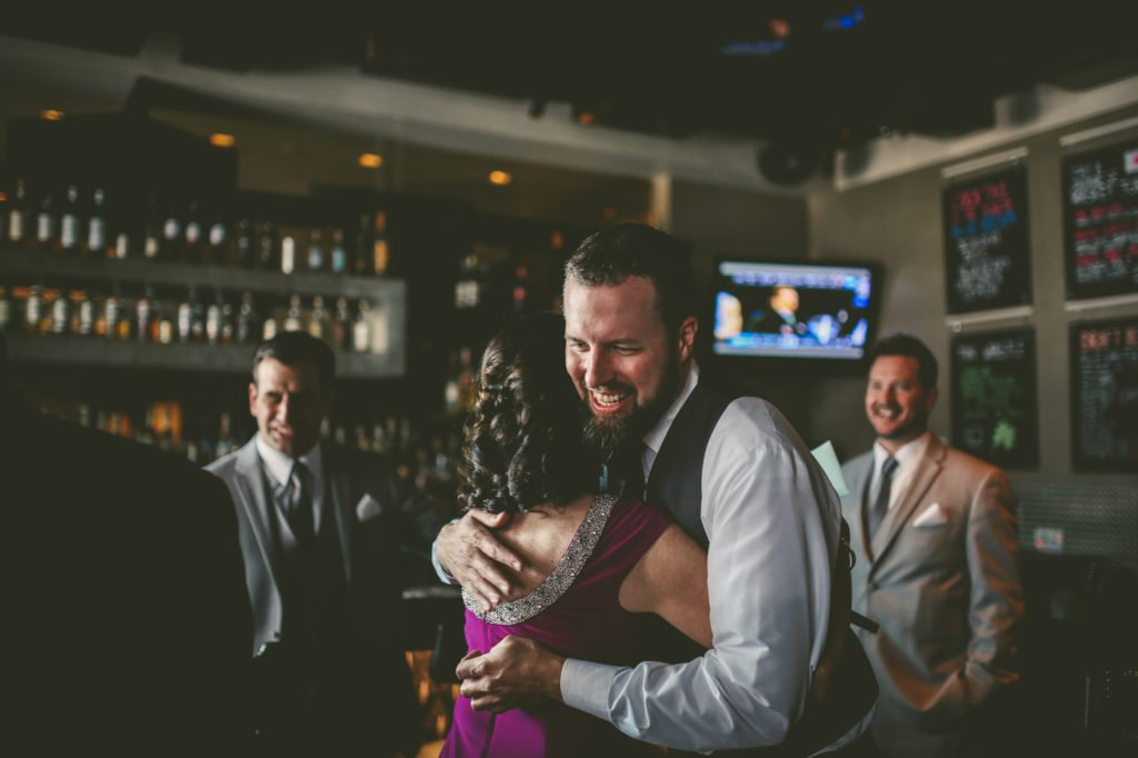 groom receiving a hug
