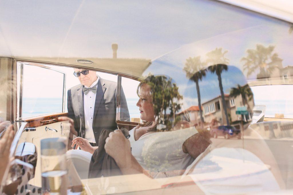 San Diego Same Sex Elopement: Couple with vintage limousine