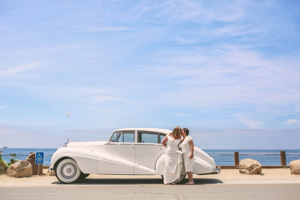 San Diego Same Sex Elopement: Couple with vintage limousine