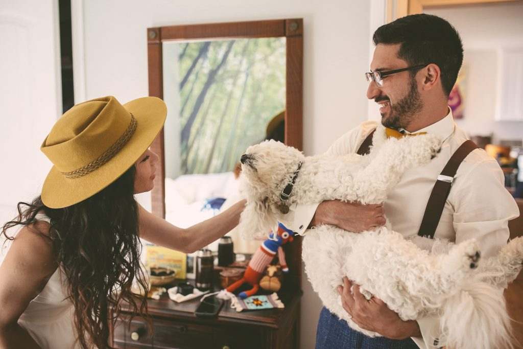Pre-Wedding Portrait Session: Getting ready together with dog