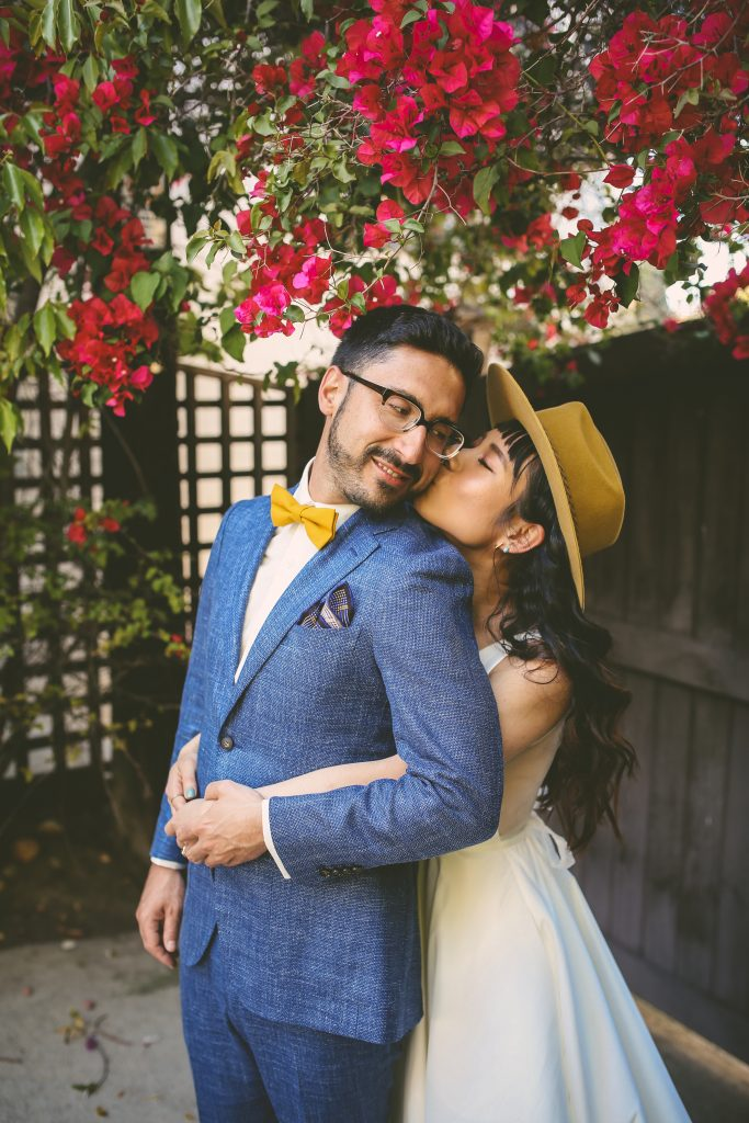 Pre-Wedding San Diego Portrait Session: couple with bougainvillea